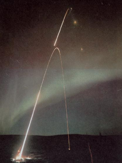 Rocket launch at night.